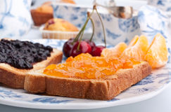Two toasts with jam. Two toasts with orange and cherry jam Stock Photos