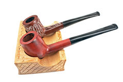 Two tobacco pipes on wooden holder Royalty Free Stock Photos