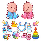 Two toddler, with baby items. Stock Photo