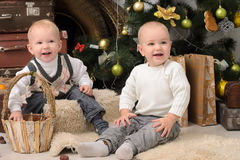 Two toddler boys in christmas interior Royalty Free Stock Photos