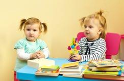 Two toddler girls playing Royalty Free Stock Image