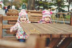 Two toddlers in cafe stock images