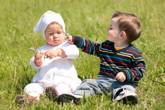 Two toddlers on the grass Royalty Free Stock Photography