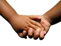 Two toddlers holding hands. royalty free stock images