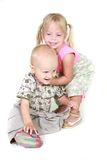 Two toddlers playing. Over white stock photo