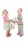 Two toddlers playing. Over white royalty free stock images