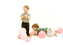Two toddlers playing royalty free stock photo