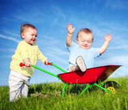 Two Toddlers Playing Together Outdoors.  royalty free stock image
