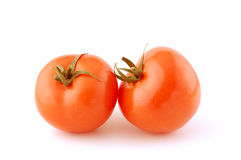 Two tomato. Isolated on a white. Studio shoot stock photography