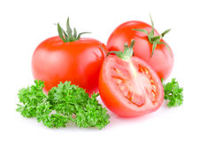 Two tomato cut in half and a sprig of parsley Royalty Free Stock Image