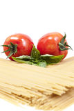 Two tomatoes and basil Stock Photography
