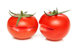 Two tomatoes with mouths Stock Photos