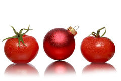 Two tomatoes and one red christmas ball Stock Photography