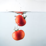 Two tomatoes splash Stock Photo