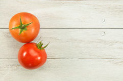 Two tomatoes vegetable. Fresh wet tomatoes vegetable on wood table Stock Photography