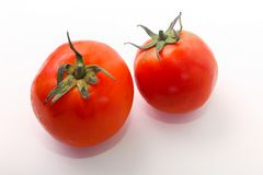 Two tomatoes on white. Two fresh tomatoes on white , healthy food, vegetarian Stock Images