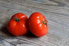 Two Tomatoes on Wood Table Stock Image