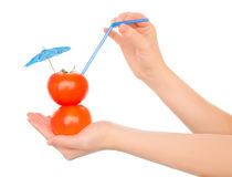 Two Tomatos With Straw And Cocktail Umbrella Stock Image