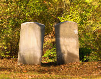 Two tombstones. In an old cemetary with no engraving in autumn Royalty Free Stock Photo