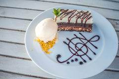 Two tone cake with ice cream on the dish Royalty Free Stock Photography