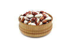 Two-tone grain beans in a wooden bowl Stock Photo