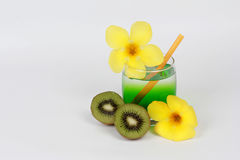 Two tone of kiwi juice served with halves kiwi and yellow flower on white background. Two tone of kiwi juice served  is popular healthy food for diet and Stock Photography
