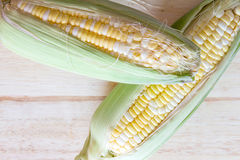 Two tone of sweet Corn on wooden background Royalty Free Stock Photography