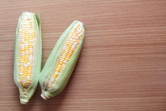 Two tone of sweet Corn on wooden background Royalty Free Stock Image