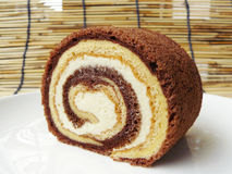 Two tone vanilla and chocolate roll cake Royalty Free Stock Photos
