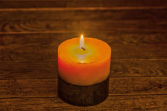 Two-toned candlelight illuminating the wooden background Royalty Free Stock Image