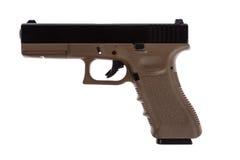Two tones modern pistol on white Royalty Free Stock Photos