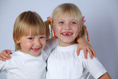 Two tooghless girls Stock Photo
