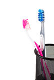 Two tooth-brushes in glass Stock Image