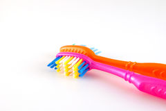 Two tooth-brushes over white Stock Photography