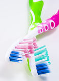 Two toothbrushes. Two colorful toothbrushes on white background Royalty Free Stock Photo
