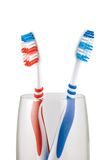 Two Toothbrushes. In glass, isolated on white Royalty Free Stock Image