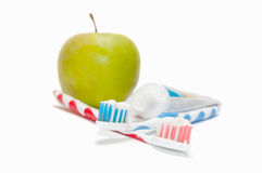 Two toothbrushes and apple Royalty Free Stock Photography