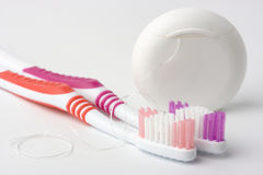Two toothbrushes and dental floss Stock Photo