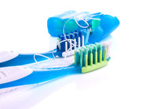 .Two toothbrushes and dental floss isolated Stock Image