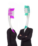 Two toothbrushes dressed in clothes. Conceptual photo. Two toothbrushes dressed in clothes. Concept stock image