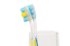 Two toothbrushes in a glass Royalty Free Stock Photography