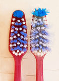 Two toothbrushes: a new and very old. Royalty Free Stock Photos