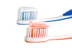 Two toothbrushes with paste Royalty Free Stock Photography