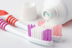 Two toothbrushes and toothpaste Royalty Free Stock Images
