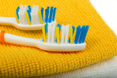 Two toothbrushes on a towel Royalty Free Stock Images