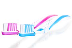Two toothbrushes are on white Royalty Free Stock Images