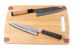 Two top grade japanese knives on cutting board Stock Images