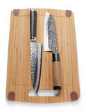 Two top grade japanese knives on cutting board Royalty Free Stock Photography