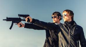 Two tough guys. Portrait of two tough guys with guns Stock Photography