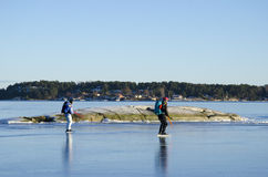 Two tour skaters in Stockholm archipelago Royalty Free Stock Photography